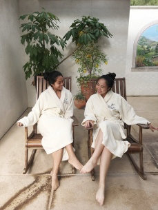 Two women sitting on rocking chairs in a tropical room at Glen Ivy Spa