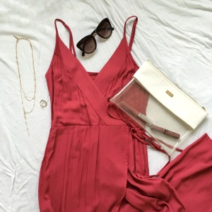 Red wrap dress with clear hand bag and sunglasses